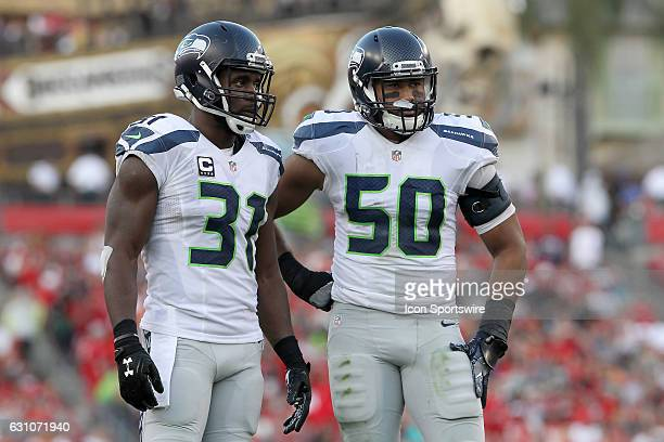 Kam Chancellor and K J Wright of the Seahawks talk before the snap of the football during the NFL Game between the Seattle Seahawks and Tampa Bay...