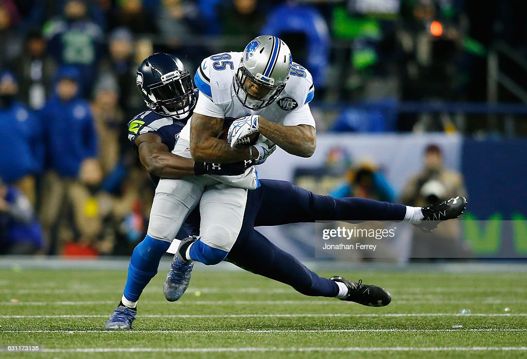 Kam Chancellor #31 of the Seattle Seahawks attempts to tackle Eric Ebron #85 of the Detroit Lions during the first half of the NFC Wild Card game at CenturyLink Field on January 7, 2017 in Seattle, Washington.
