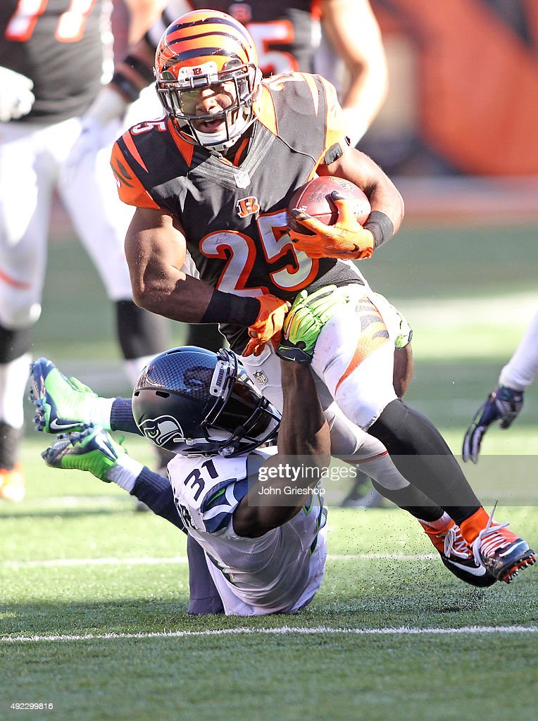 Kam Chancellor #31 of the Seattle Seahawks attempts to tackle Giovani Bernard #25 of the Cincinnati Bengals during overtime at Paul Brown Stadium on October 11, 2015 in Cincinnati, Ohio. Cincinnati defeated Seattle 27-24 in overtime.