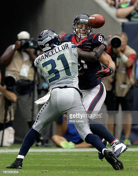 Kam Chancellor of the Seattle Seahawks breaks up a pass inntended for Owen Daniels of the Houston Texans that resulted in an interception for the...
