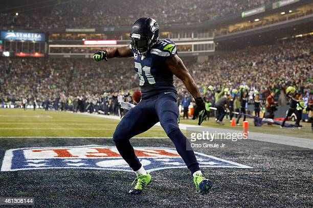 Kam Chancellor of the Seattle Seahawks celebrates after scoring a 90 yard touchdown off of an interception in the fourth quarter thrown by Cam Newton...