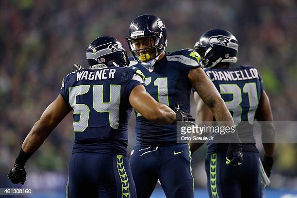 Kam Chancellor of the Seattle Seahawks celebrates with Bobby Wagner after scoring a 90 yard touchdown off of an interception in the fourth quarter...