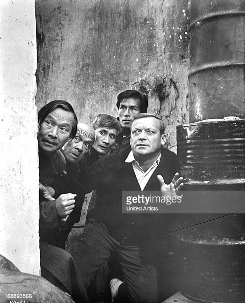 Kam Tong and several others hide with Aldo Ray in a scene from the film 'Kill A Dragon' 1967