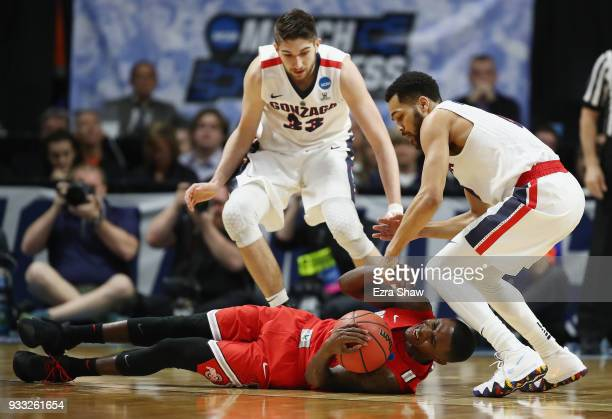 Kam Williams of the Ohio State Buckeyes battles for a loose ball against Silas Melson and Killian Tillie of the Gonzaga Bulldogs during the second...