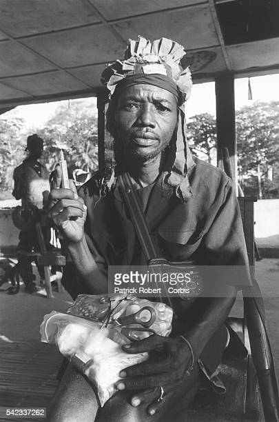 Kamajor 'doctor' he cannot read or write but gives penicillin injections to whoever wants them and many do