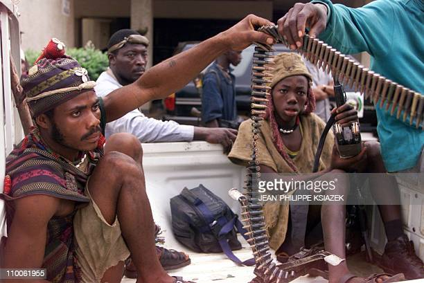 Kamajor traditional hunters who are siding with the West African peacekeeping force ECOMOG prepare their weapons 07 January in Freetown Sierra Leone...