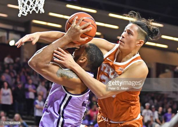 Kamaka Hepa of the Texas Longhorns fouls DaJuan Gordon of the Kansas State Wildcats during the second half at Bramlage Coliseum on February 22, 2020...