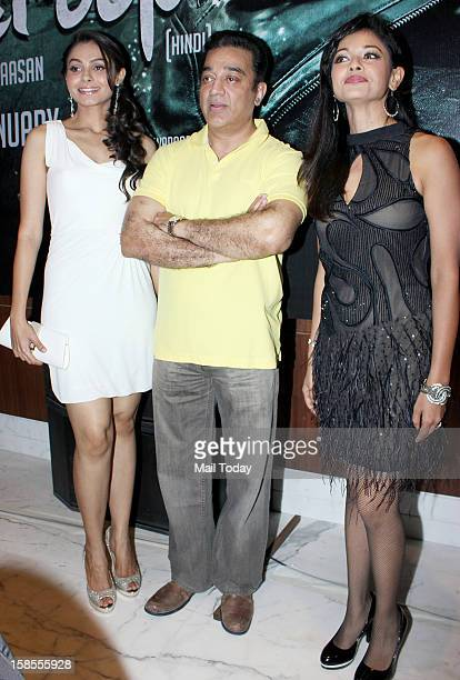 Kamal Haasan flanked by Andrea Jeremiah and Pooja Kumar during the promotion of the forthcoming dual language Tamil and Hindi film Vishwaroopam at a...