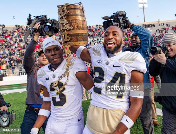 Kamal Hardy and Tim Cason of the Purdue Boilermakers carry the Ol' Oaken Bucket following the game against the Indiana Hoosiers at Memorial Stadium...