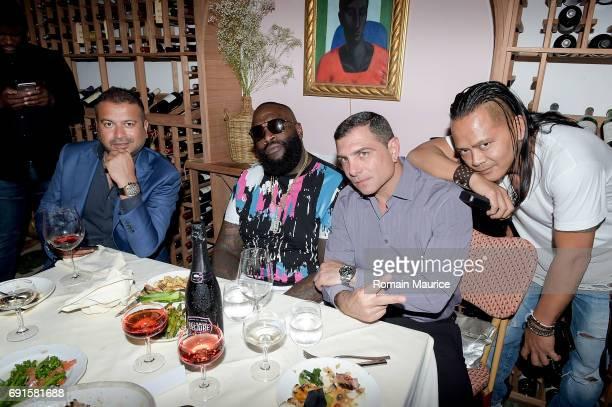 Kamal Hotchandani Rick Ross Antonio Misuraca Tamz attend Haute Living Celebrates Rick Ross at Marion Miami on June 1 2017 in Miami Florida