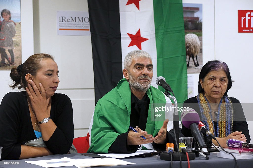 Kamal Jamal Beck (C), former director of programming at the official SANA radio and the SANA online news website in Damascus, speaks during a press conference in Paris, on December 28, 2012, as he and two other colleagues from the radio service, Lama Al-Khadra (L) and Baddour Abdel Karim (R), announce their recent defection from official Syrian state media. The three Syrian journalists said they have now joined ranks with the revolution and stated they left Syria fearing for their lives after planning to quit their jobs in protest at ongoing bloodshed and violence perpetrated by the regime of Syrian president Bachar al-Assad. More than 45,000 people have been killed in Syria since the outbreak in March 2011 of an anti-regime revolt that became a bloody insurgency after a brutal crackdown on dissent, a watchdog said on December 26.
