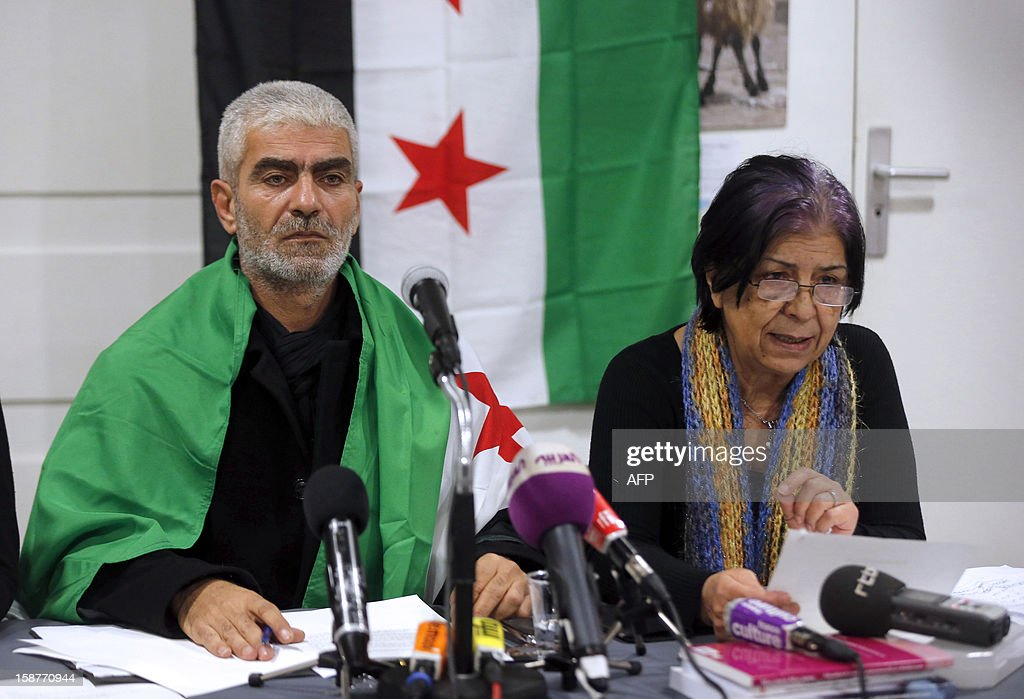 Kamal Jamal Beck (C), former director of programming at the official SANA radio and the SANA online news website in Damascus, speaks during a press conference in Paris, on December 28, 2012, as he and two other colleagues from the radio service, Lama Al-Khadra (unseen) and Baddour Abdel Karim (R), announce their recent defection from official Syrian state media. The three Syrian journalists said they have now joined ranks with the revolution and stated they left Syria fearing for their lives after planning to quit their jobs in protest at ongoing bloodshed and violence perpetrated by the regime of Syrian president Bachar al-Assad. More than 45,000 people have been killed in Syria since the outbreak in March 2011 of an anti-regime revolt that became a bloody insurgency after a brutal crackdown on dissent, a watchdog said on December 26.