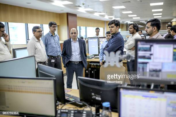 Kamal Mahajan head of treasury and global markets at Bank of Baroda fourth left stands with colleagues on the trading floor at the company's office...