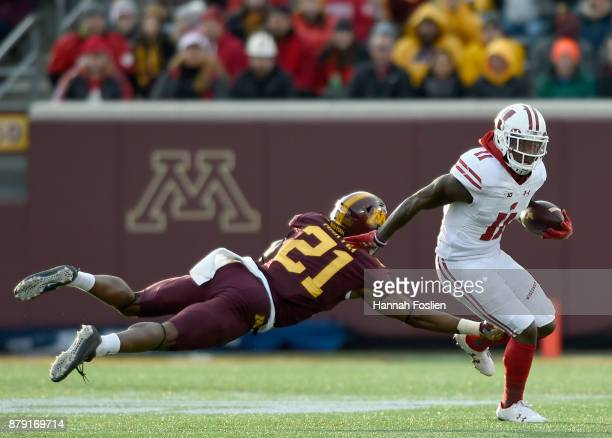 Kamal Martin of the Minnesota Golden Gophers tackles Jazz Peavy of the Wisconsin Badgers on a punt return during the second quarter of the game on...