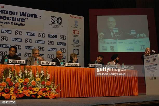 Kamal Nath Union Cabinet Minister for Commerce and Industry with Amartya SenIndian Nobel Laureate Saroj Kumar Poddar FICCI President Maxine Olson...