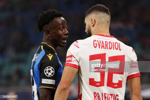 Kamal Sowah of Club Brugge confronts Antonio Nusa of Club Brugge during the UEFA Champions League group A match between RB Leipzig and Club Brugge KV...