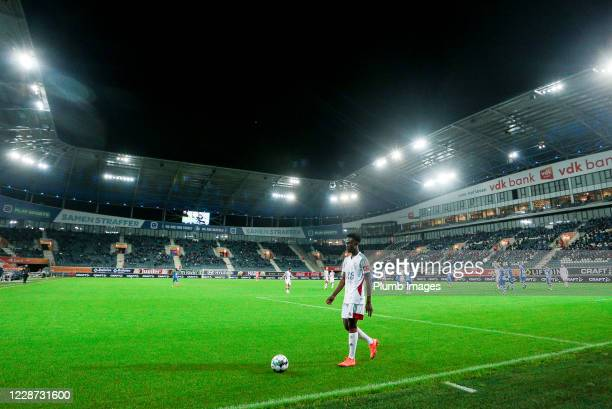 Kamal Sowah of OH Leuven walks with the ball during the Jupiler Pro League match between KAA Gent and OH Leuven at the Ghelamco Arena on September...