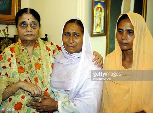 Kamala Advani wife of India's Bharatiya Janata Party President comforts Dalbir Kaur and Sukhpreet Kaur sister and wife of Sarabjit Singh an Indian...