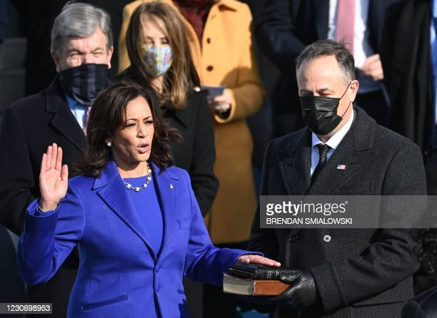 Kamala Harris, flanked by her husband Doug Emhoff, is sworn in as the 49th US Vice President by Supreme Court Justice Sonia Sotomayor on January 20...