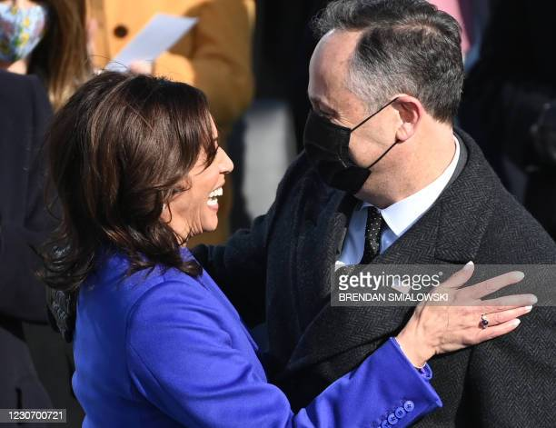 Kamala Harris is embraced by her husband Doug Emhoff after being sworn in as the 49th US Vice President by Supreme Court Justice Sonia Sotomayor on...