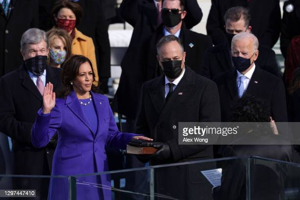Kamala Harris is sworn in as U.S. Vice President as her husband Doug Emhoff looks on during the inauguration of U.S. President-elect Joe Biden on the...