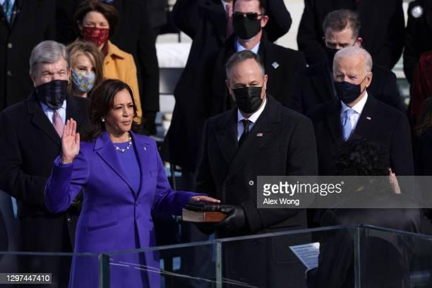 Kamala Harris is sworn in as U.S. Vice President as her husband Doug Emhoff looks on during the inauguration of U.S. President-elect Joe Biden on the...