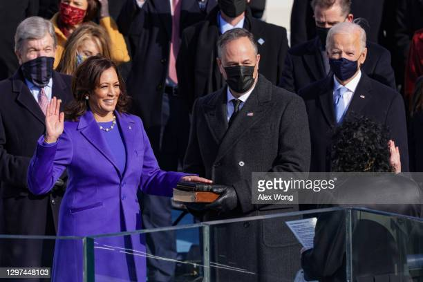 Kamala Harris is sworn in as U.S. Vice President by U.S. Supreme Court Associate Justice Sonia Sotomayor as her husband Doug Emhoff looks on at the...