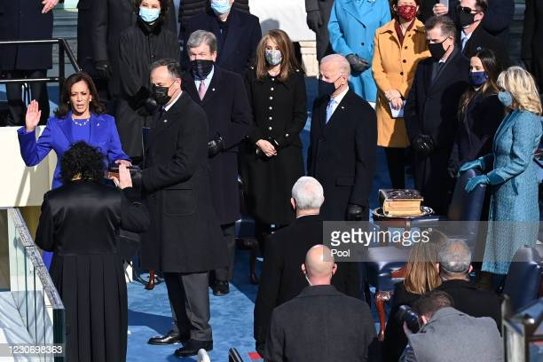 Kamala Harris is sworn in as vice president by Supreme Court Justice Sonia Sotomayor as her husband Doug Emhoff holds the Bible during the 59th...