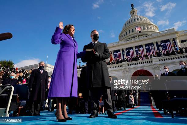 Kamala Harris , with her husband Second Gentleman Doug Emhoff, is sworn in by Justice Sonia Sotomayor as US President-elect Joe Biden look on as the...