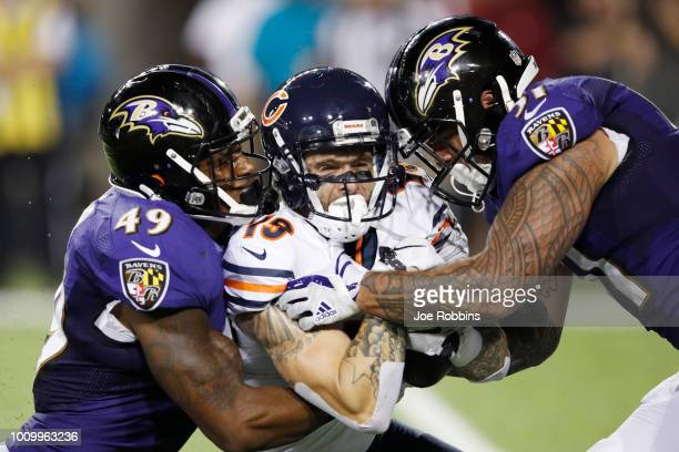 Kamalei Correa and Chris Board of the Baltimore Ravens are called for an illegal hit while tackling Tanner Gentry of the Chicago Bears in the third...