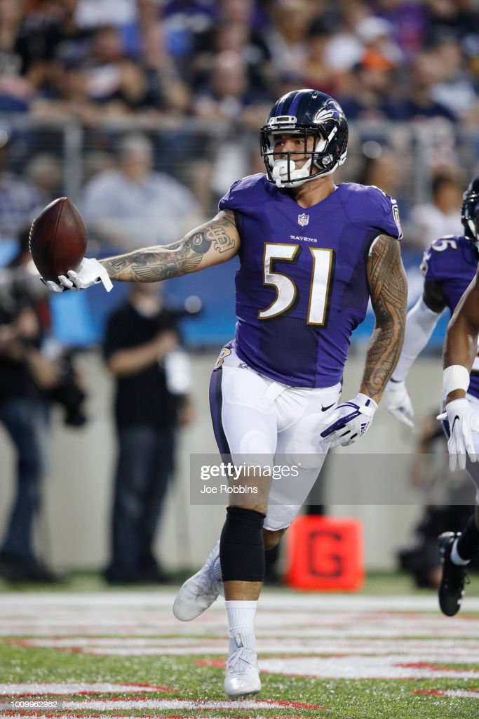 Kamalei Correa #51 of the Baltimore Ravens reacts after an interception in the first quarter of the Hall of Fame Game against the Chicago Bears at Tom Benson Hall of Fame Stadium on August 2, 2018 in Canton, Ohio.