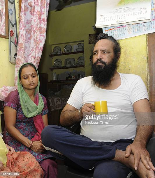 Kamaljeet Singh Sikh victims of the 1984 riots and resident of Trilok Puri with his wife on October 28 2014 in New Delhi India The current communal...