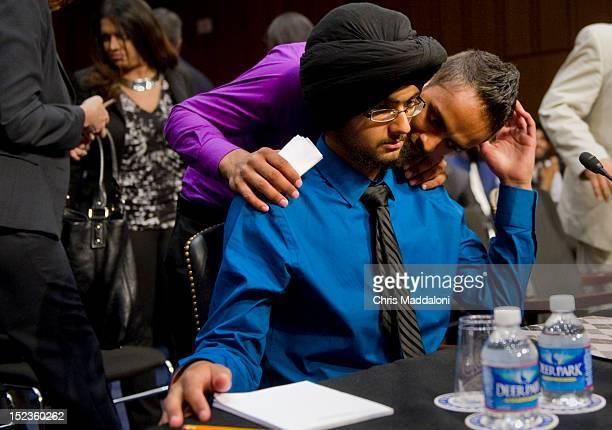 Kamaljit Singh Saini wishes his brother Harpreet Singh Saini luck before he testifies at a Senate Judiciary Constitution Civil Rights and Human...