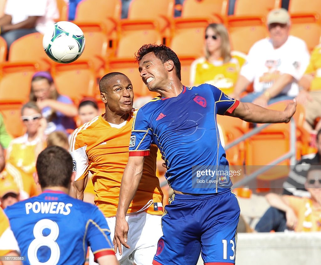 Kamani Hill #13 of the Colorado Rapids and Ricardo Clark #13 of the Houston Dynamo go up for a header at BBVA Compass Stadium on April 28, 2013 in Houston, Texas.