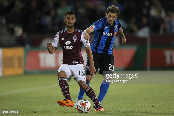 Kamani Hill of the Colorado Rapids controls the ball against Hernan Bernardello of the Montreal Impact at Dick's Sporting Goods Park on May 24 2014...