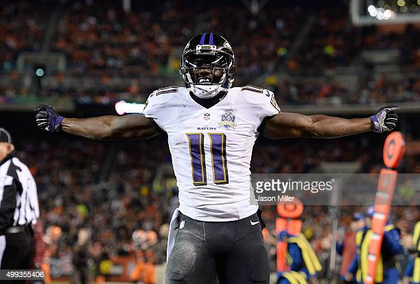 Kamar Aiken of the Baltimore Ravens celebrates his touchdown during the third quarter against the Cleveland Browns at FirstEnergy Stadium on November...