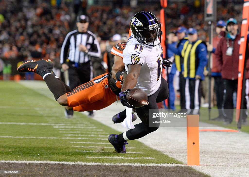 Kamar Aiken #11 of the Baltimore Ravens dives for a touchdown during the third quarter against the Cleveland Browns at FirstEnergy Stadium on November 30, 2015 in Cleveland, Ohio.