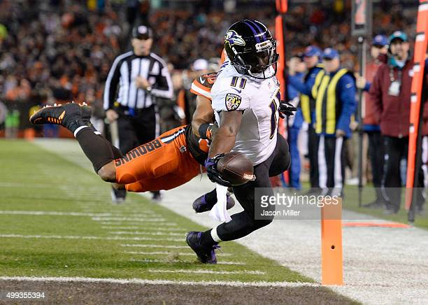 Kamar Aiken of the Baltimore Ravens dives for a touchdown during the third quarter against the Cleveland Browns at FirstEnergy Stadium on November...