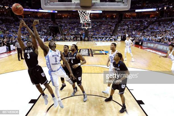 Kamar Baldwin of the Butler Bulldogs and Theo Pinson of the North Carolina Tar Heels compete for a rebound in the first half during the 2017 NCAA...