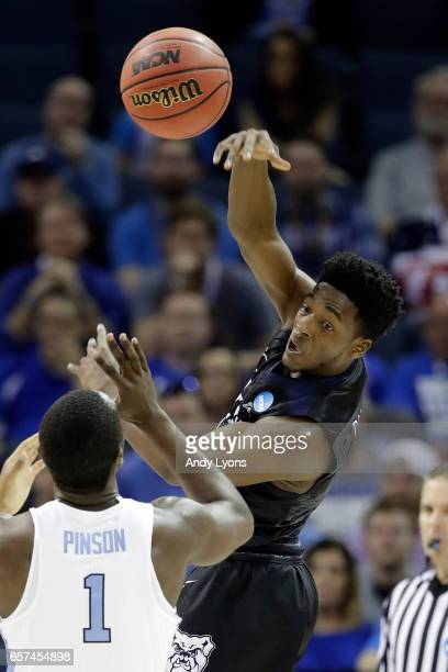 Kamar Baldwin of the Butler Bulldogs passes in the first half against Theo Pinson of the North Carolina Tar Heels during the 2017 NCAA Men's...
