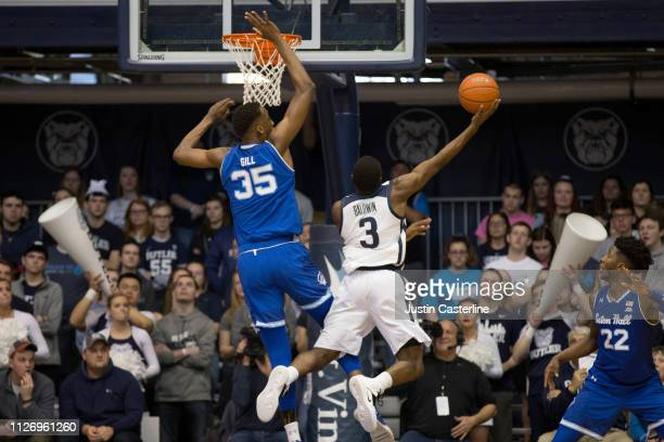 Kamar Baldwin of the Butler Bulldogs puts up a shot against Romaro Gill of the Seton Hall Pirates during the second half at Hinkle Fieldhouse on...