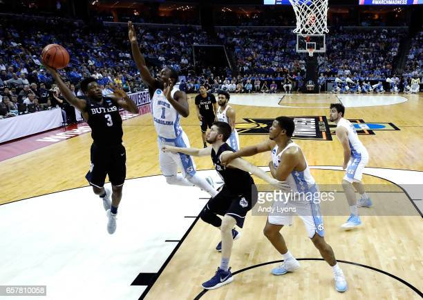 Kamar Baldwin of the Butler Bulldogs shoots against Theo Pinson of the North Carolina Tar Heels in the second half during the 2017 NCAA Men's...