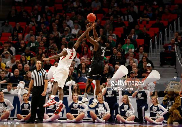 Kamar Baldwin of the Butler Bulldogs shoots over F Adrio Bailey of the Arkansas Razorbacks during the NCAA Division I Men's Basketball First Round...