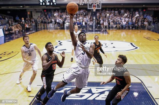 Kamar Baldwin of the Butler Bulldogs shoots the ball as Jose Morales of the Princeton Tigers looks on at Hinkle Fieldhouse on November 12 2017 in...