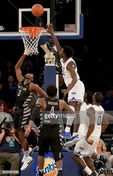 Kamar Baldwin of the Butler Bulldogs takes a shot as Myles Cale of the Seton Hall Pirates defends in the final minutes of the game during...