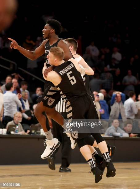 Kamar BaldwinPaul Jorgensen and Nate Fowler of the Butler Bulldogs celebrate the win over the against the Seton Hall Pirates during quarterfinals of...