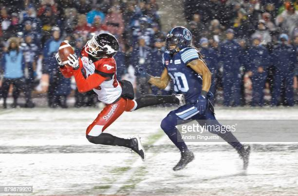 Kamar Jorden of the Calgary Stampeders makes a diving catch against Rico Murray of the Toronto Argonauts during the second half of the 105th Grey Cup...