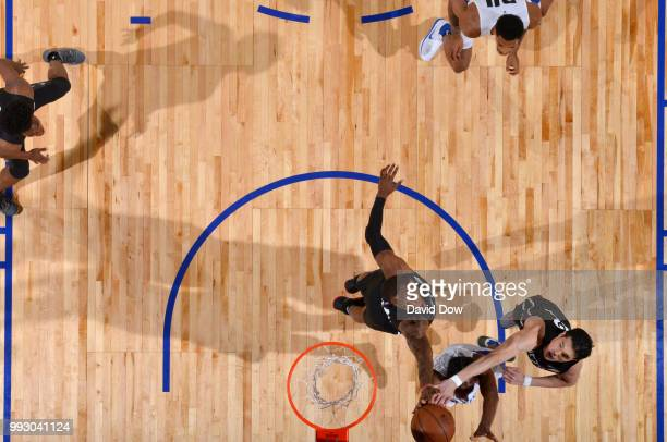 Kamari Murphy and Yuta Watanabe of the Brooklyn Nets contest a shot by the Orlando Magic during the 2018 Las Vegas Summer League on July 6 2018 at...