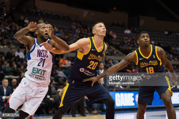 Kamari Murphy of the Long Island Nets Jarrod Uthoff of the Fort Wayne Mad Ants DeQuan Jones of the Fort Wayne Mad Ants during an NBA GLeague game on...