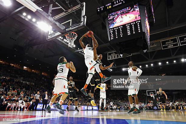 Kamari Murphy of the Miami Hurricanes battles for the rebound with Anton Grady of the Wichita State Shockers in the first half of their game during...